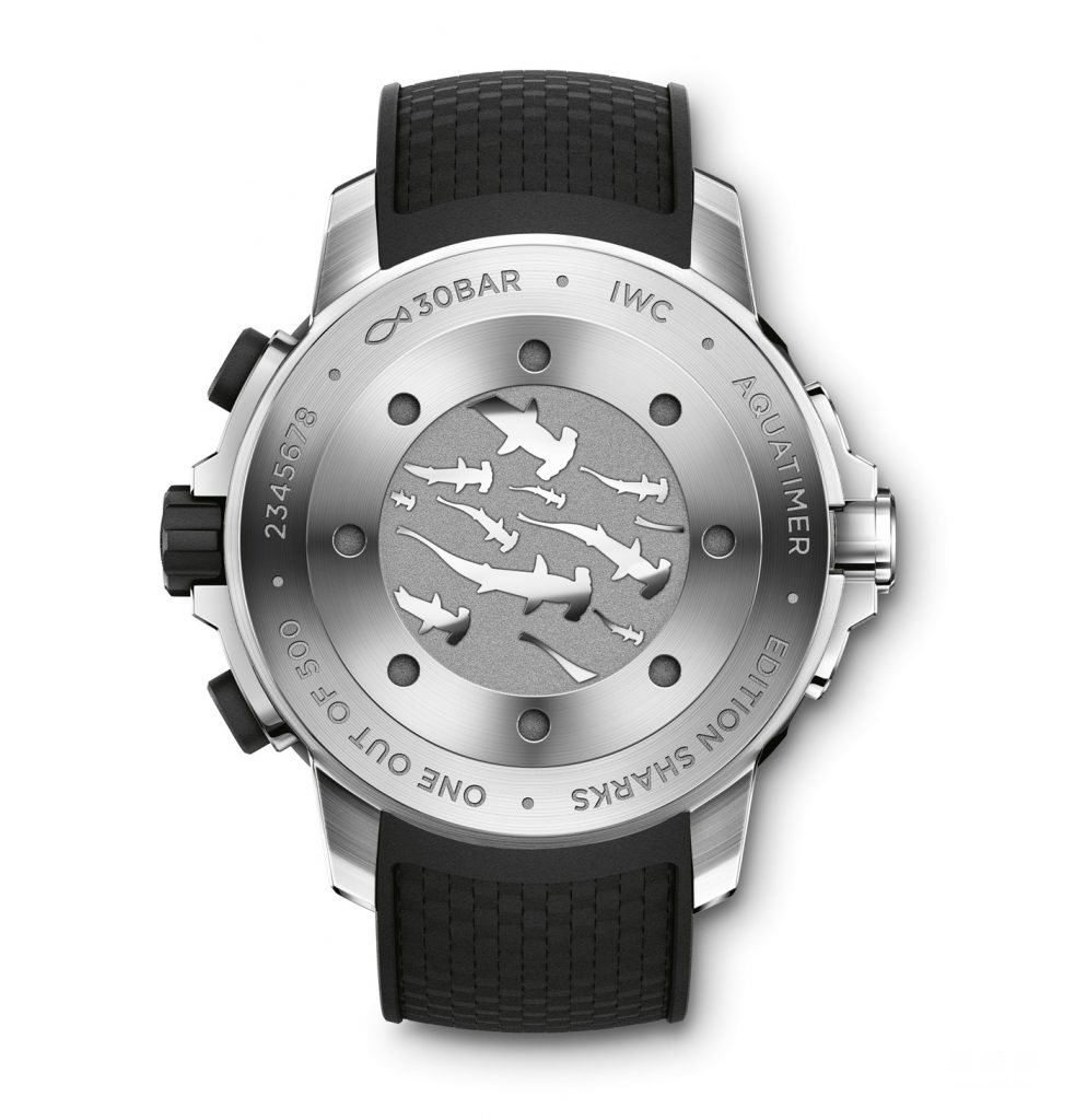 The pattern of  a group of swimming hammerhead sharks have been engraved on the center of the caseback.