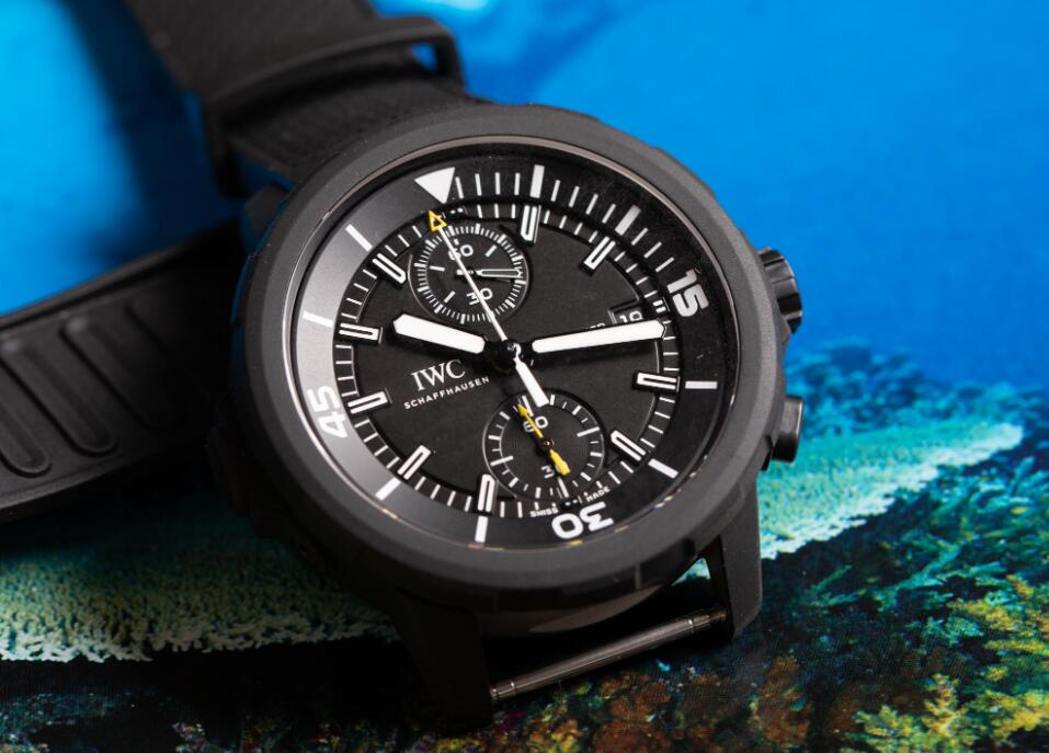 The white and yellow elements are contrasted to the black dial of the best fake IWC.